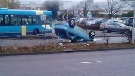 The overturned car on Lytton Way in Stevenage. Picture: Jeremy Williams.