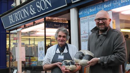 Butcher Tony Kisielowski and Andrew Webb hold up their chieftains in front of Burtons Butchers on Ki