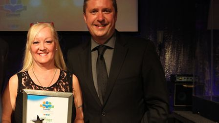 Jackie Nealon pictured with host David Croft after winning the Valiant Volunteer Award last year.
