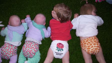 Tots taking it easy in their cloth nappies.