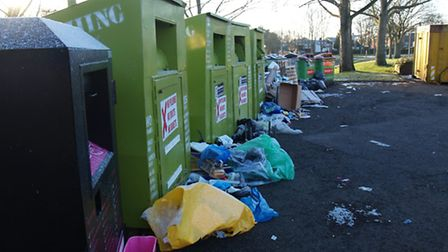 Rubbish left by the recylcing bins has been called an 'eyesore' by people in the area,