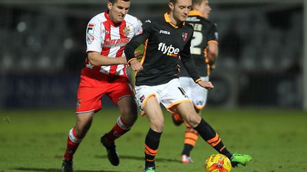 David McAllister, left, in action against Exeter City last month. Photo: Harry Hubbard
