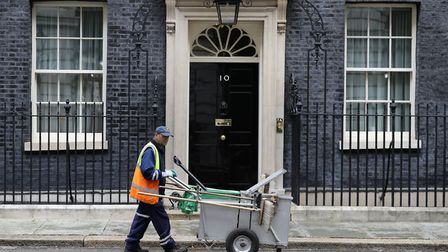 A street cleaner outside 10 Downing Street in London. Picture: Aaron Chown/PA Wire