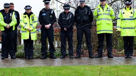 Officers at Herts police observing a silence to remember victims in the Paris massacre. Picture: @He