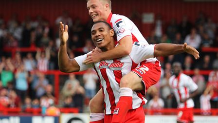 Tom Conlon celebrates with Darius Charles in the first meeting between Stevenage and Shrewsbury, whi