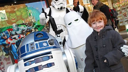 Curtis Creese, 4 poses with some Star Wars characters outside Limited Edition Comix