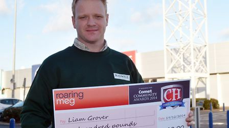 Liam Grover with his cheque