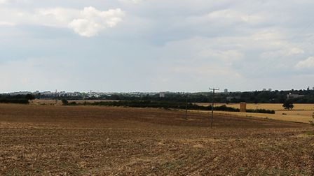 Stevenage town can clearly be seen across the field where a proposed solar farm would be built