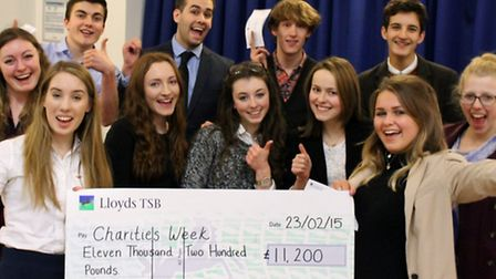 Students from Saffron Walden County High School celebrate raising more than £11,000 from their chari