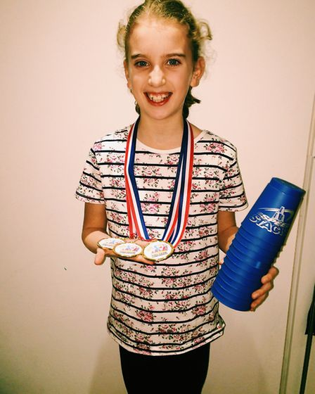 A delighted Sophie Godfrey with her haul of medals.