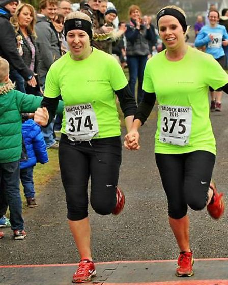 Philippa Haigh and Emily Smith cross the finishing line together.