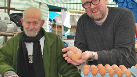 Andrew Webb with Simon Elam from Hempstead at Saffron Walden Market. Simon has been in the egg busin