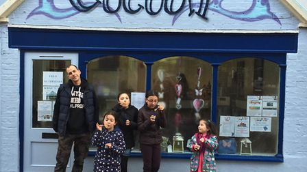 Blowing bubbles outside The Craft Cocoon.
