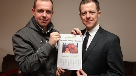 Lee Hobbs with Gary Hobbs. holding their fundraising poster
