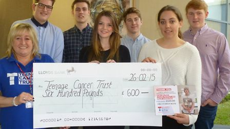 A-level Leisure Studies students at Saffron Walden County High present a cheque for £600 to Teenage