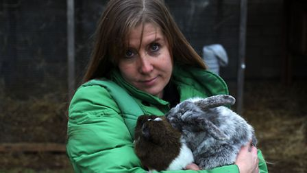 Alison Fishpool with one of her pet rabbits and a guinea pig