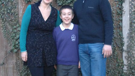Jonah Lewis, 7, with parents Monica and Paul.