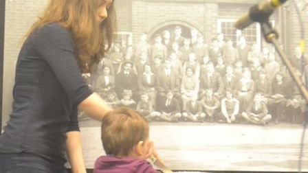 The oldest girl, Catherine, and youngest boy, Bart, cutting the centenary cake. Credit: Holly Bazley