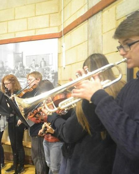Musicians accompany the singing of the school song and Jerusalem at the St Christopher centenary ass