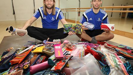 Jay Drackford and Jordan Wilson, staff at Marriotts School, with pencil cases for Gambia