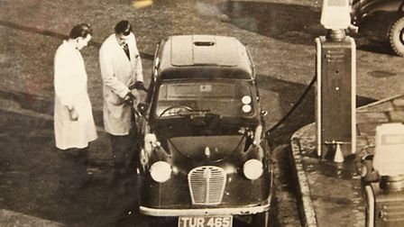 The search is on for the man on the left in the picture working at Stevenage Motor company