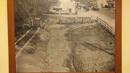 The picture showing the filling in of a pond in the 1930's