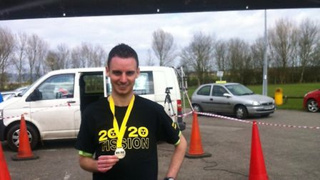 Nick with his medal after completing the 20/20 Fission race in Gloucestershire.