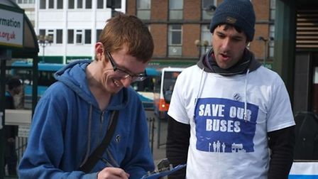 A passerby signs the Save Our Buses petition which gathered more than 500 signatures at Stevenage Bu