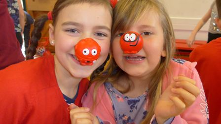 Schoolchildren at St Thomas More wearing their red noses.