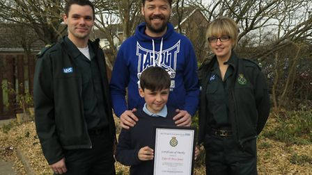 Tyler D-Arcy-Jones with his dad Lee, East of England Ambulance Service call handler George Lock and