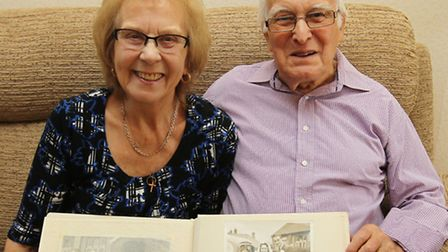 Hazel and John Hynard with a picture from their wedding day