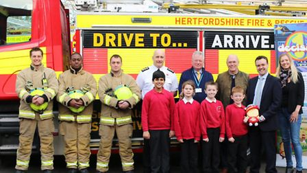 Hayley Sherwood of Stevenage charity 1Decision, MP Stephen McPartland and Stevenage firefighters and