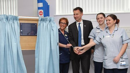 Jeremy Hunt officially unveils the plaque with the help of senior sister Liz Hall and nurses Charlen