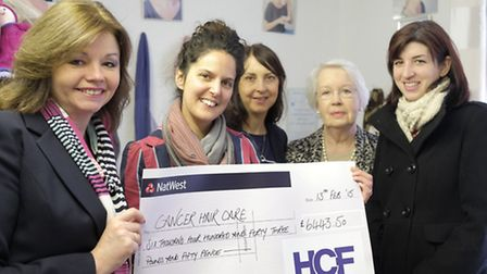Clare Austin presents Stevenage-based Cancer Hair Care with a cheque for 5,443.50 from the Herts Com