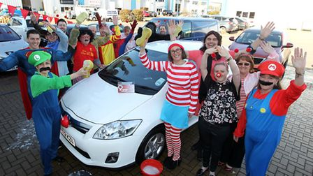 Staff at the SEC Group and Toyota Materials Handling's East Anglia team have their sponges at the re