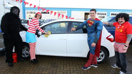 There's a joke in here somewhere: Toyota and SEC Group staff all dressed up for the cause.