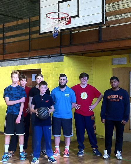 Teenagers pose for a picture before playing a game of basketball, one of many activities on offer at