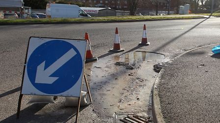 Spilled sewage on Six Hills Way, at the roundabout with Brittian Way