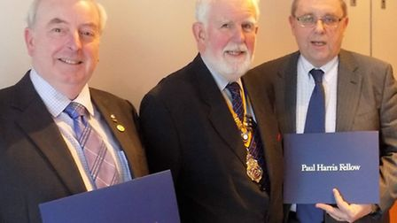 Alan Fuller of MBDA, right, and Iain Shepherd of Riding For The Disabled receive Paul Harris Fellows