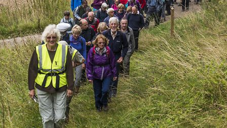Terry Ingle (Stevenage Leisure 50) briefs a group of Walkers on St Ippolyts Green.