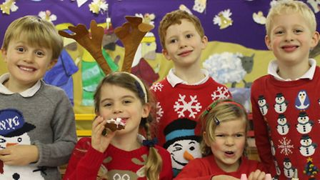 Youngsters at RA Butler primary school enjoy the Christmas fair.