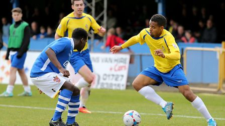 Jo N'Guessan, right, in action against Staines Town. Picture: Leigh Page