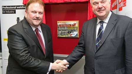 Weldability SIF managing director Adrian Hawkins shakes hands with Sir Oliver Heald in front of the