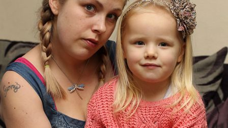 Terri Hessing with her daughter Jessica who pricked her finger on a needle wedged in a seat of a bus