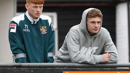 Stevenage's Ben Kennedy (right) watches the Royston Town match