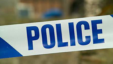 A woman was punched in the face on Sunday during an attempted bag snatch.