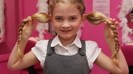 Joni Taylor, 8 before she has her hair cut off for Cancer Hair Care at Lyn Ward Hairdressers