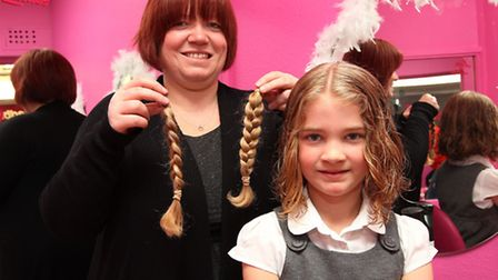 Dawn Taylor with Joni, 8 and her pigtails which she has cut off to raise money for Cancer Hair Care
