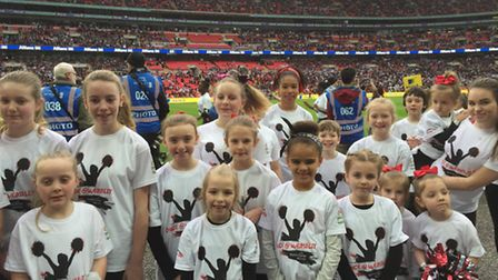 Dancers from Ambition Dance School and Purwell Panthers perform at Wembley Stadium.