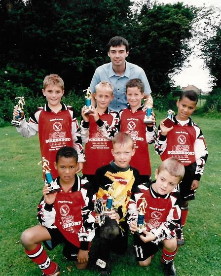 Jack Wilshere, front row far right, with a trophy won playing for Letchworth Garden City Eagles U9s.